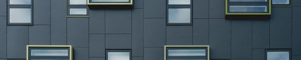 Black and yellow gold apartment block cladding