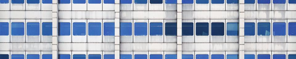 Grey office with blue windows